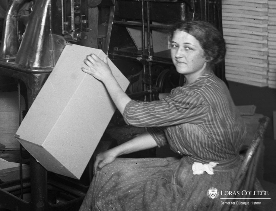 Woman working in a box factory