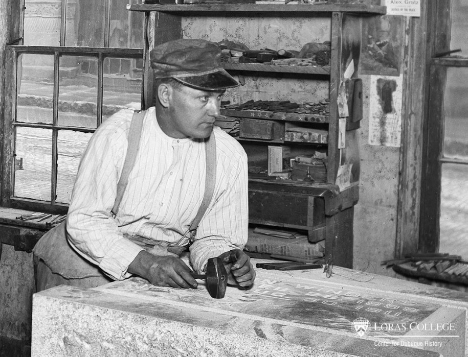Stone carver at the Dubuque Monument Company