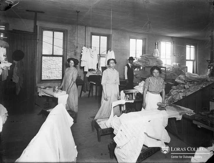 Based on her investigation of laundries in 1915, Iowa's woman factory inspector reported that the constant standing and continual use of the arm, combined with the heat and steam, made hand ironing one of the heavy jobs of laundry work. In one Dubuque laundry, however, the female ironers earned only half as much as the male drivers who brought home $12/week. (Lorenz Laundry, 1912)
