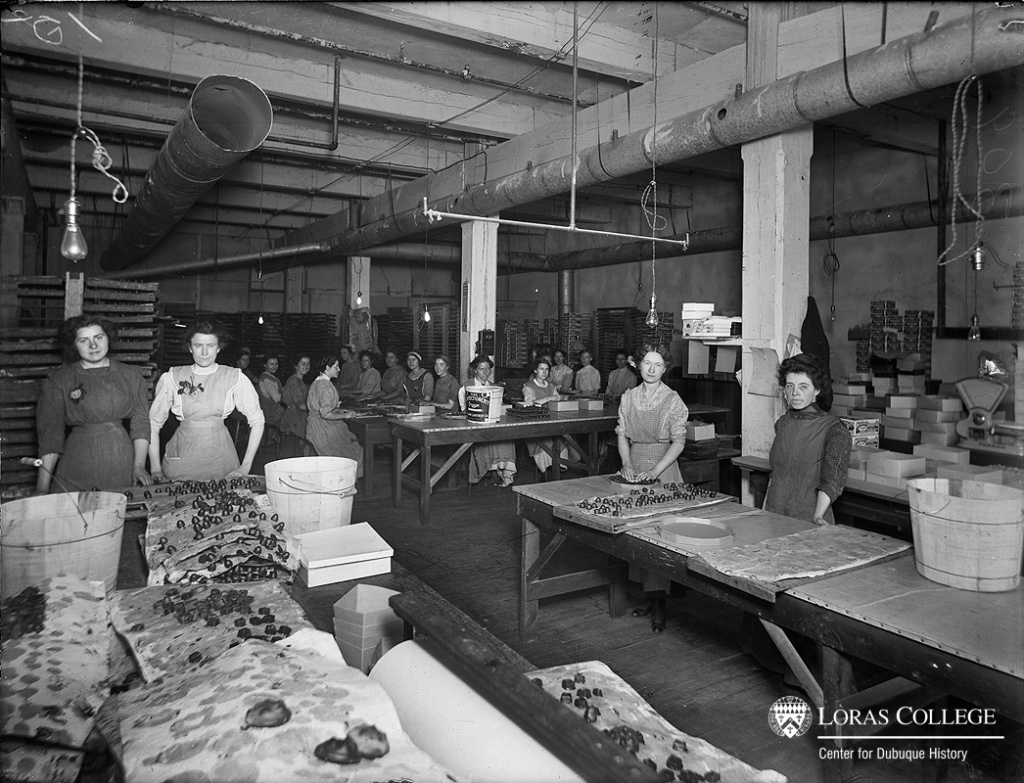 Candymaking operations employed women only to dip the candies in chocolate and to package them. The highly paid men who mixed up the batches of candy worked on a separate floor. The long, regular hours of the candy factory employees grew even longer during the holiday season. (William Lawther Company)