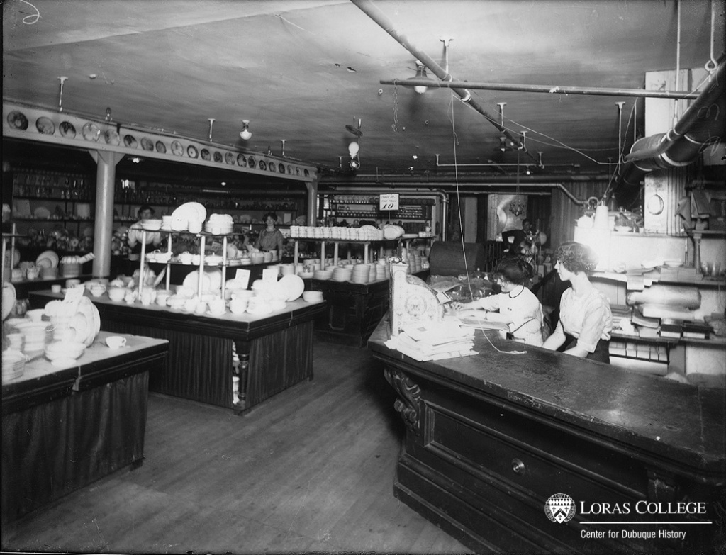 "Clerks wanted seats behind the counters so that they could get off their feet occasionally. Before they convinced the store management to provide seats for the clerks, a cashier remembered that ""women were quitting because it was so hard."" (Becker-Hazelton Company, Dubuque, Iowa, 1912)"